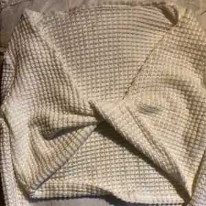 white sweater with bantou  knot in front